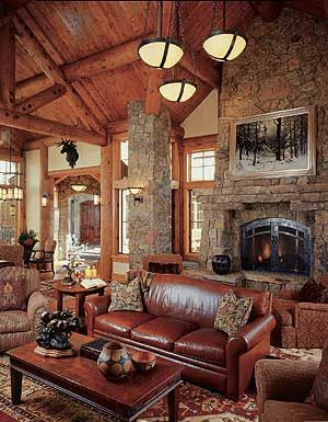 I would fill in the area left of the fireplace where the window is with more of the rock like the fireplace, and put a huge TV there.. Then arrange the furniture to face the lovely fireplace and TV. Perfect...