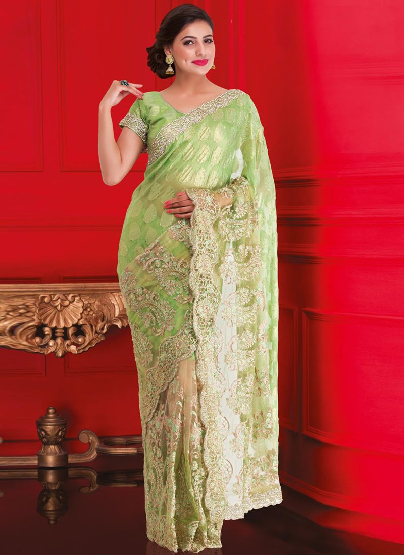 http://www.sareesaga.in/index.php?route=product/product&product_id=16896 Style	:	Designer Saree	 shipping Time	:	10 to 12 Days Occasion	:	Wedding Festival	 Fabric	:	Brasso Colour	:	Green	 Work	:	Embroidered Patch Border Work For Inquiry Or Any Query Related To Product,  Contact :- +91 9825192886