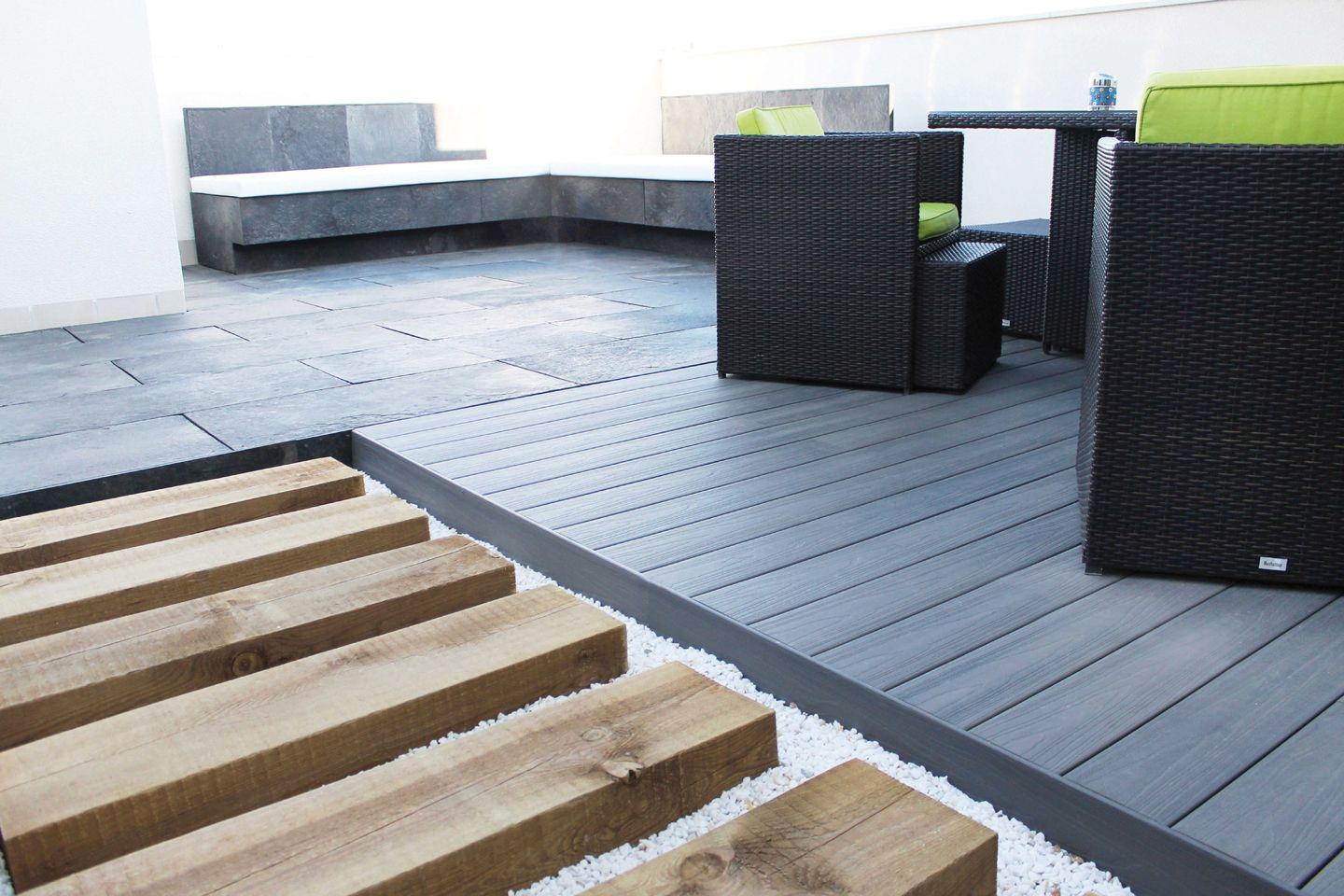 Mixed media make up this dynamic terrace from the slate for Composite decking planks