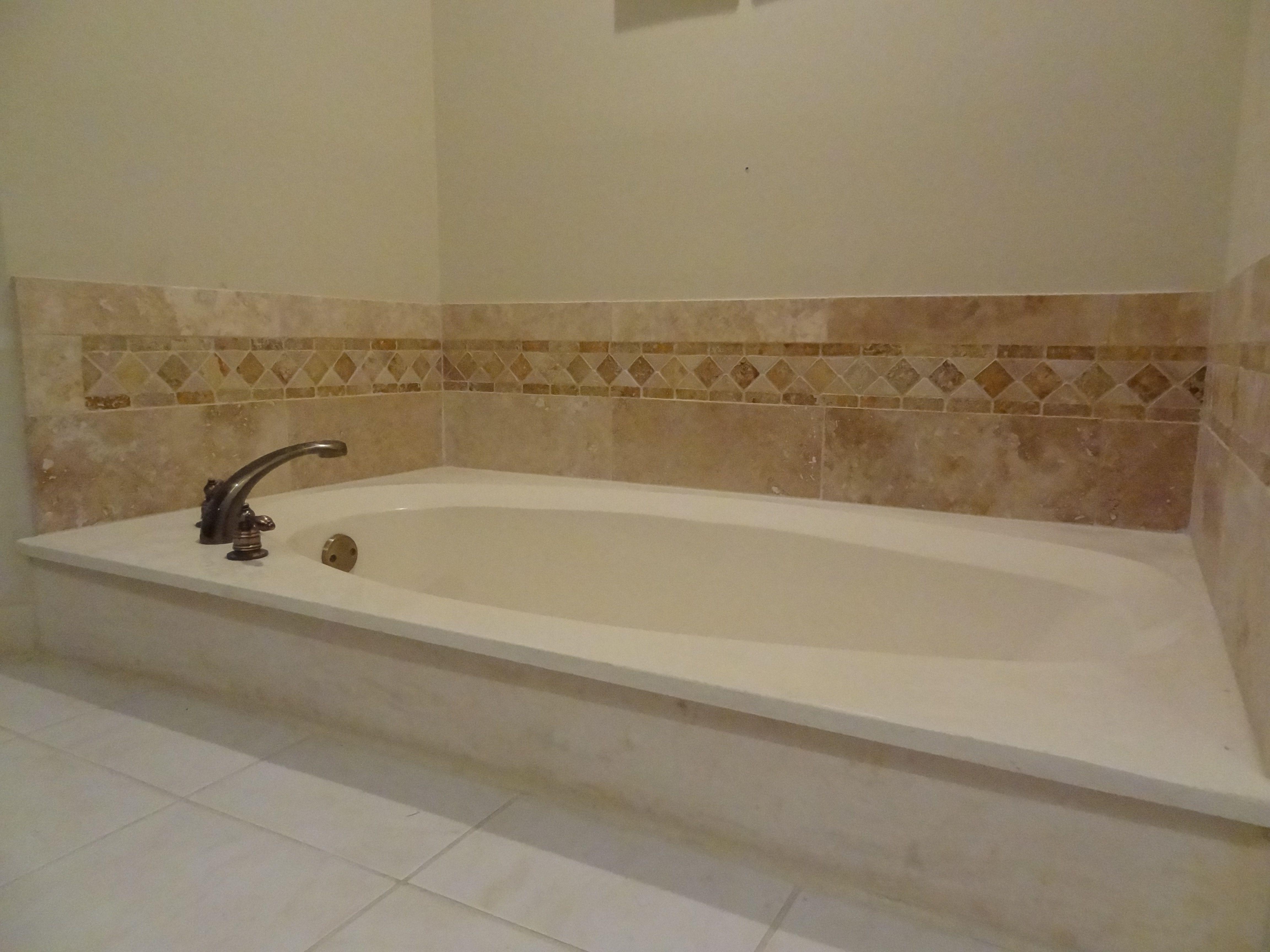 Our own finished bathtub backsplash of travertine tile | Tile ...