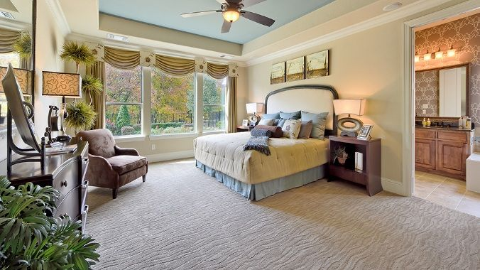 Large Windows Allow Plenty Of Natural Light Into The Master Bedroom At Star Creek