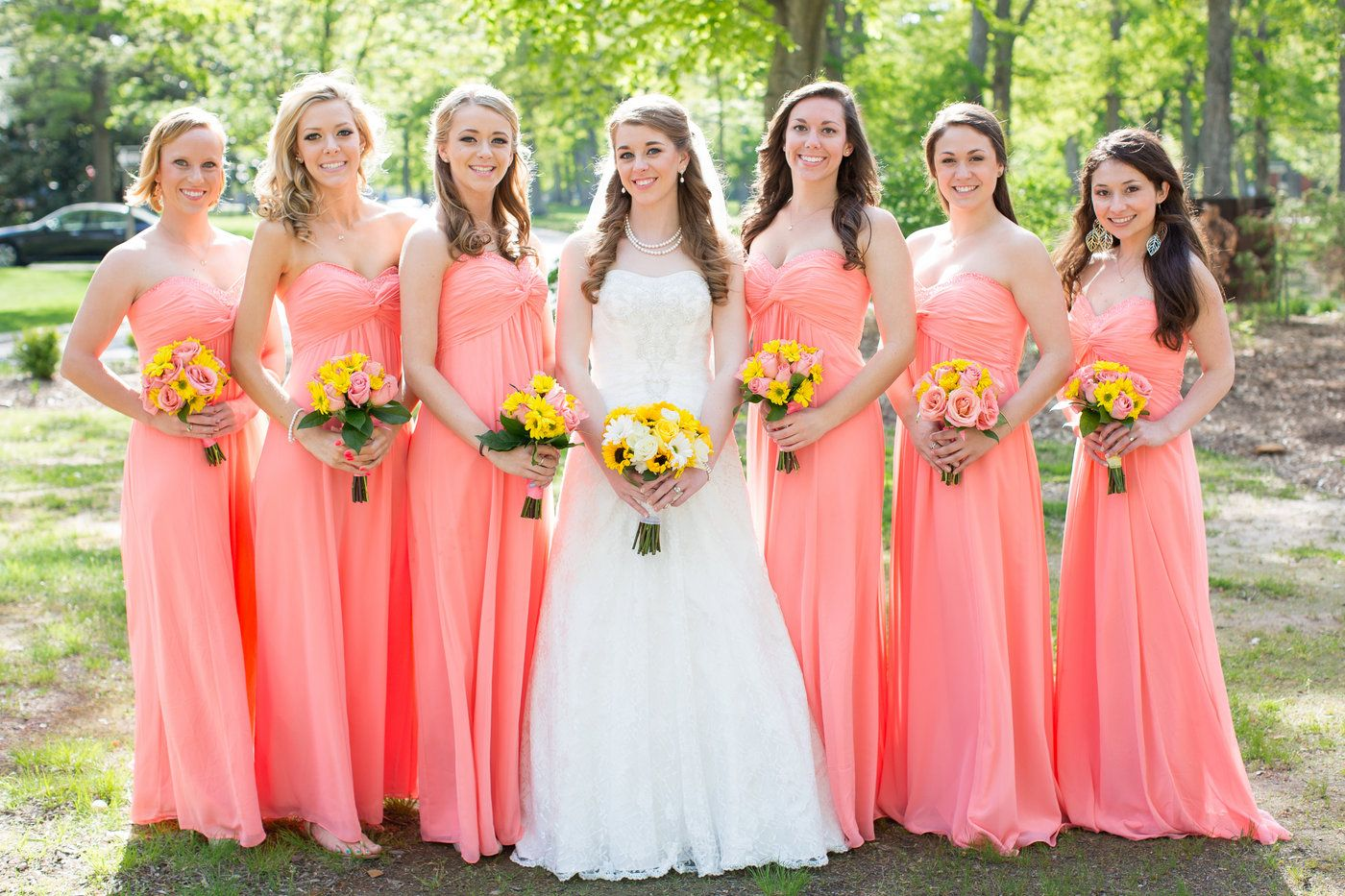 Sunflower bridal bouquet with light coral bridesmaid dresses ...