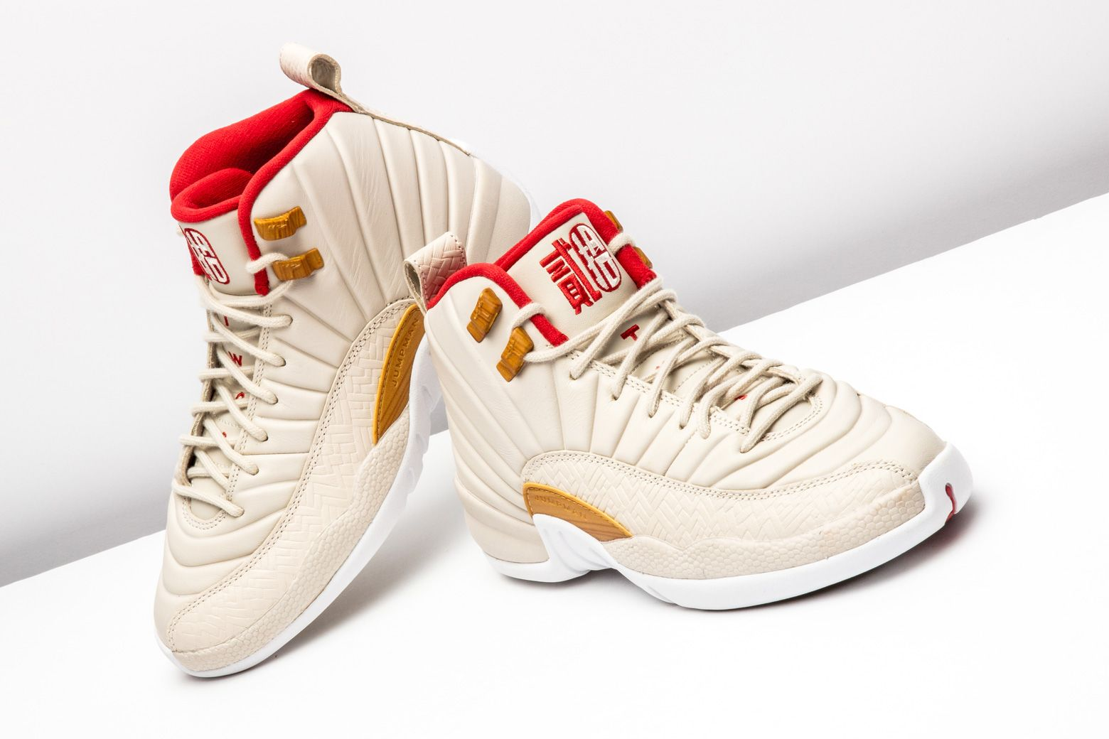 98806d32512 Jordan Brand celebrates Chinese New Year with this clean Air Jordan 12 for  girls. http