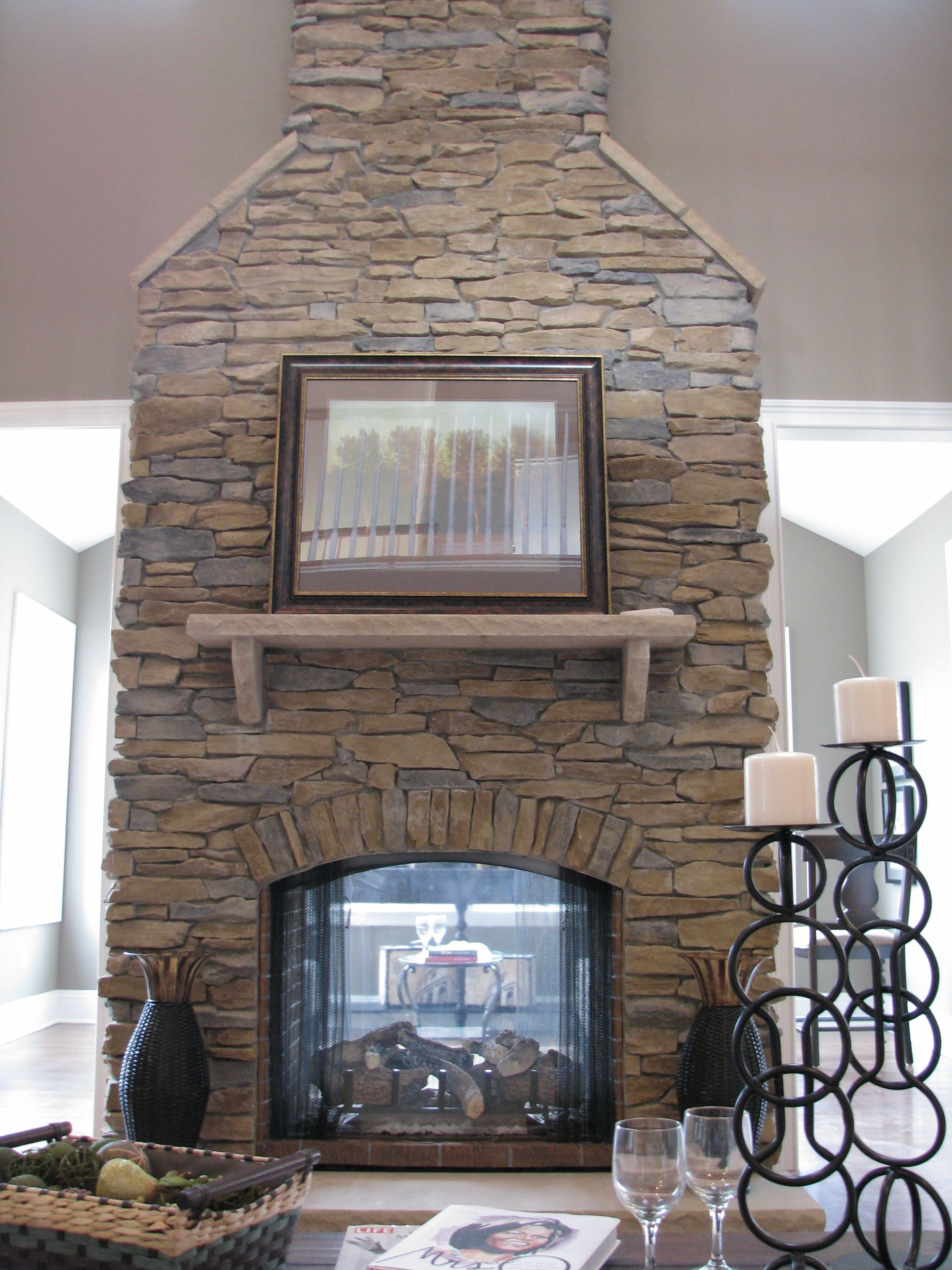 exactly what i want floor to ceiling stone fireplace with see