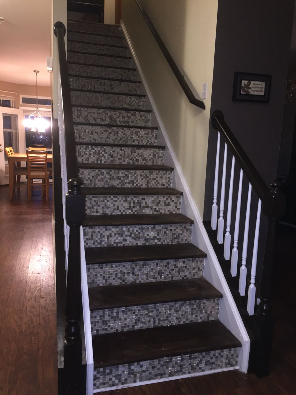 Tore up carpet, stained treads, glass mosaic tiles on the risers, repainted spindles and rails.