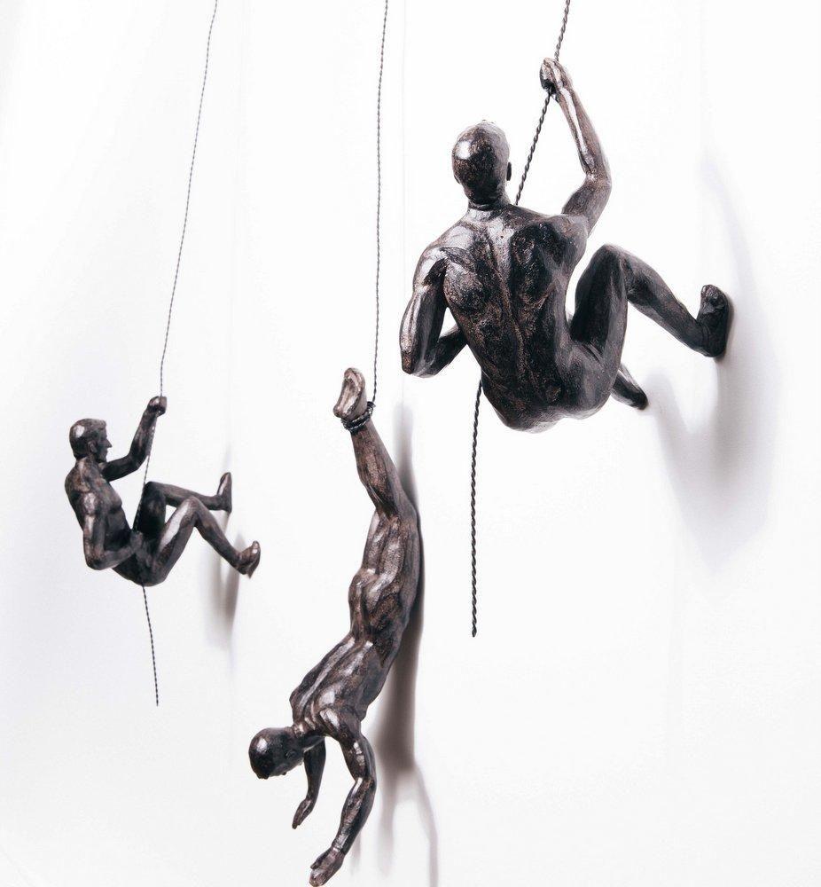 Bronze climbing men trio in 2020 wall sculptures