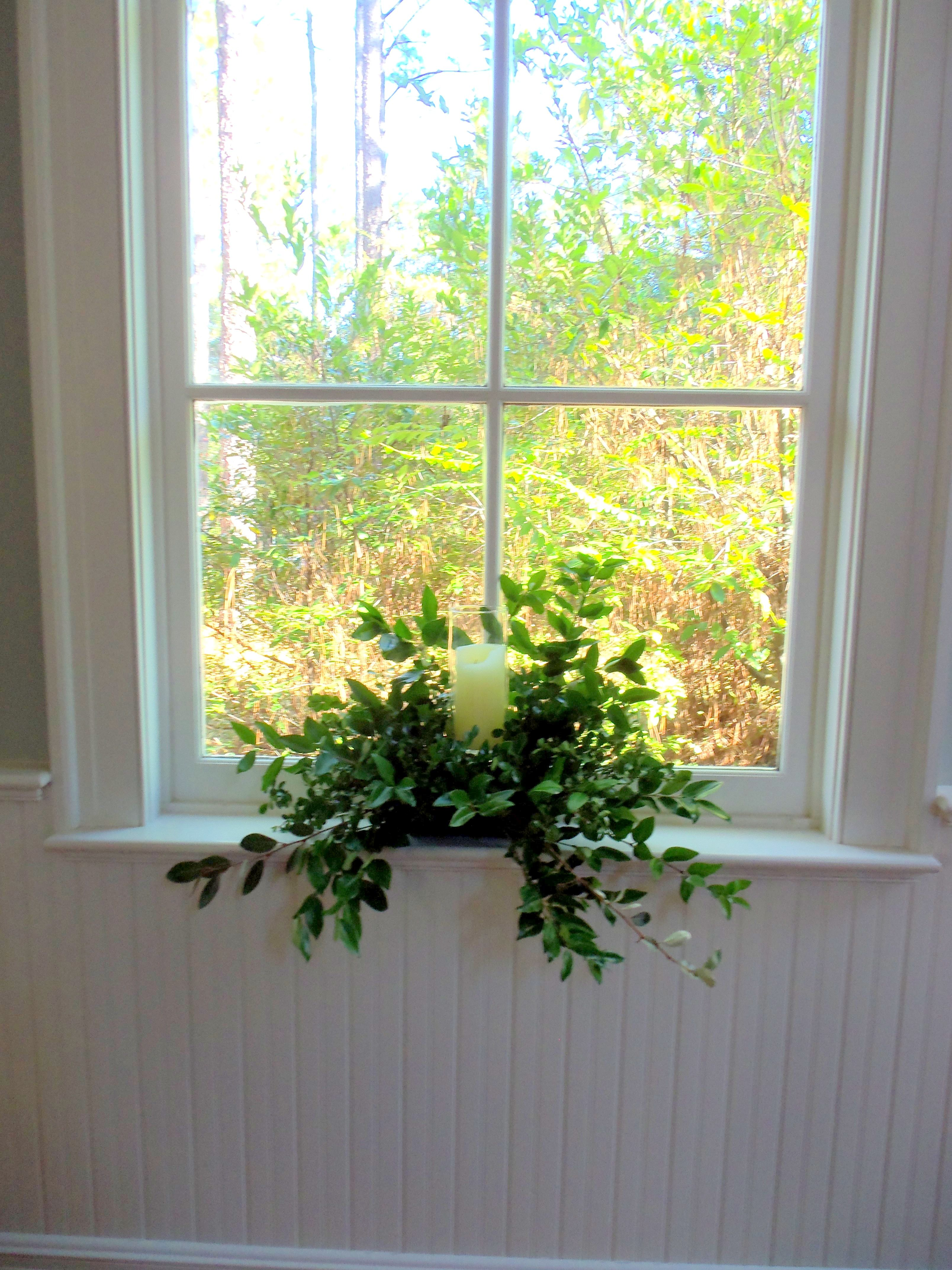 Candles and greenery to accent the church windows ...