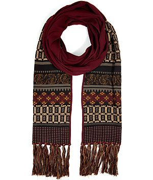 A bright patchwork of patterning lends a classically-chic look to this soft wool scarf from Etro #Stylebop
