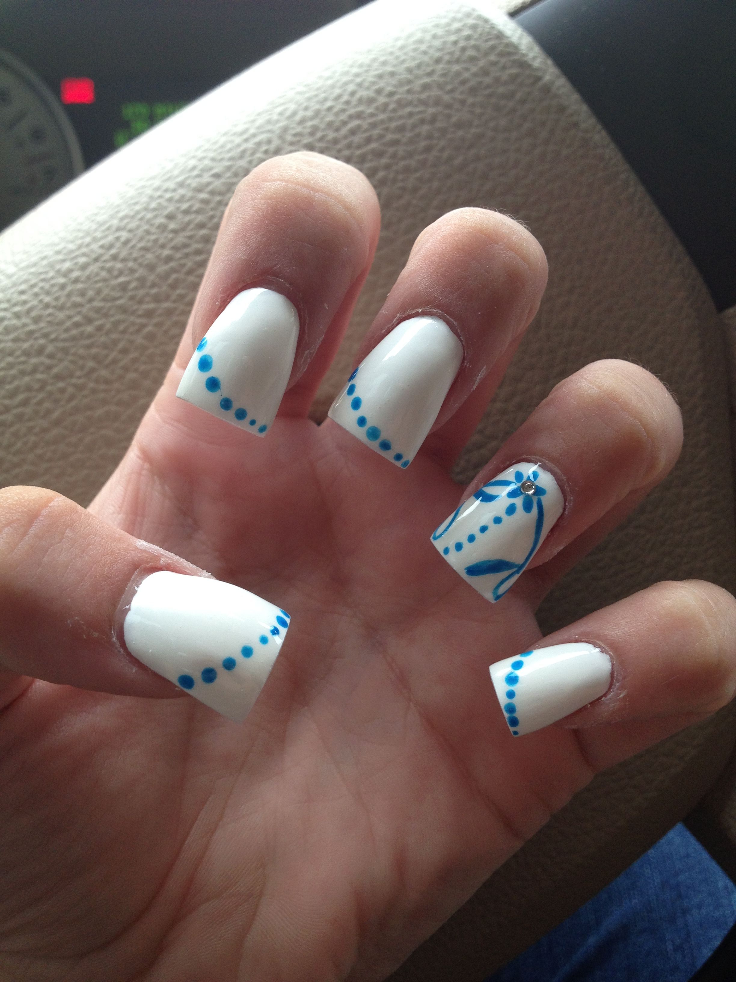 Acrylic tips - White nail polish with blue nail designs & diamond on ...