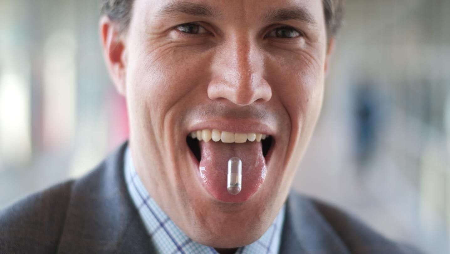 Bettinger and his non-toxic, ingestible battery. Source: Bettinger Lab