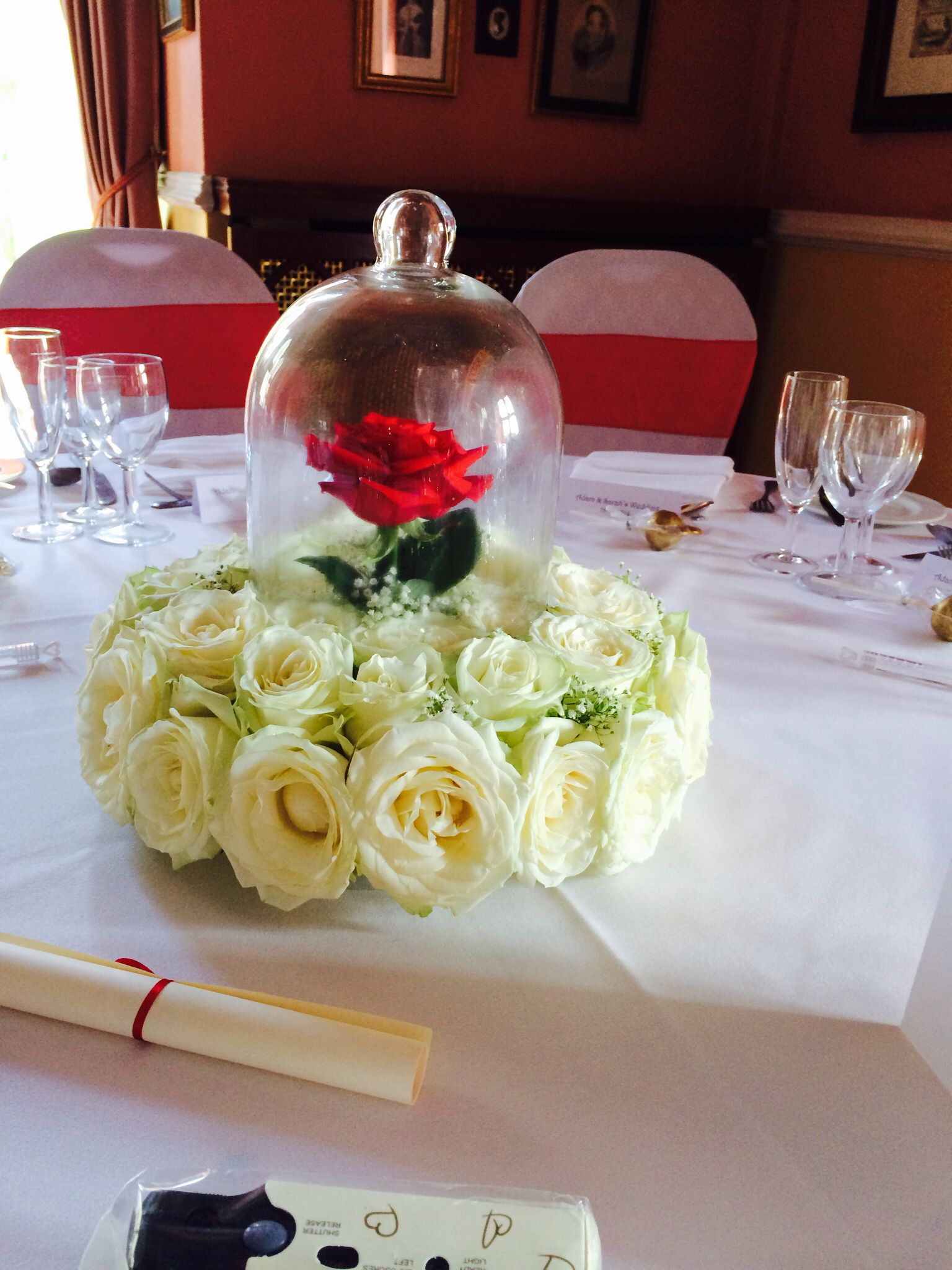 beauty and the beast table decoration in disney theme wedding