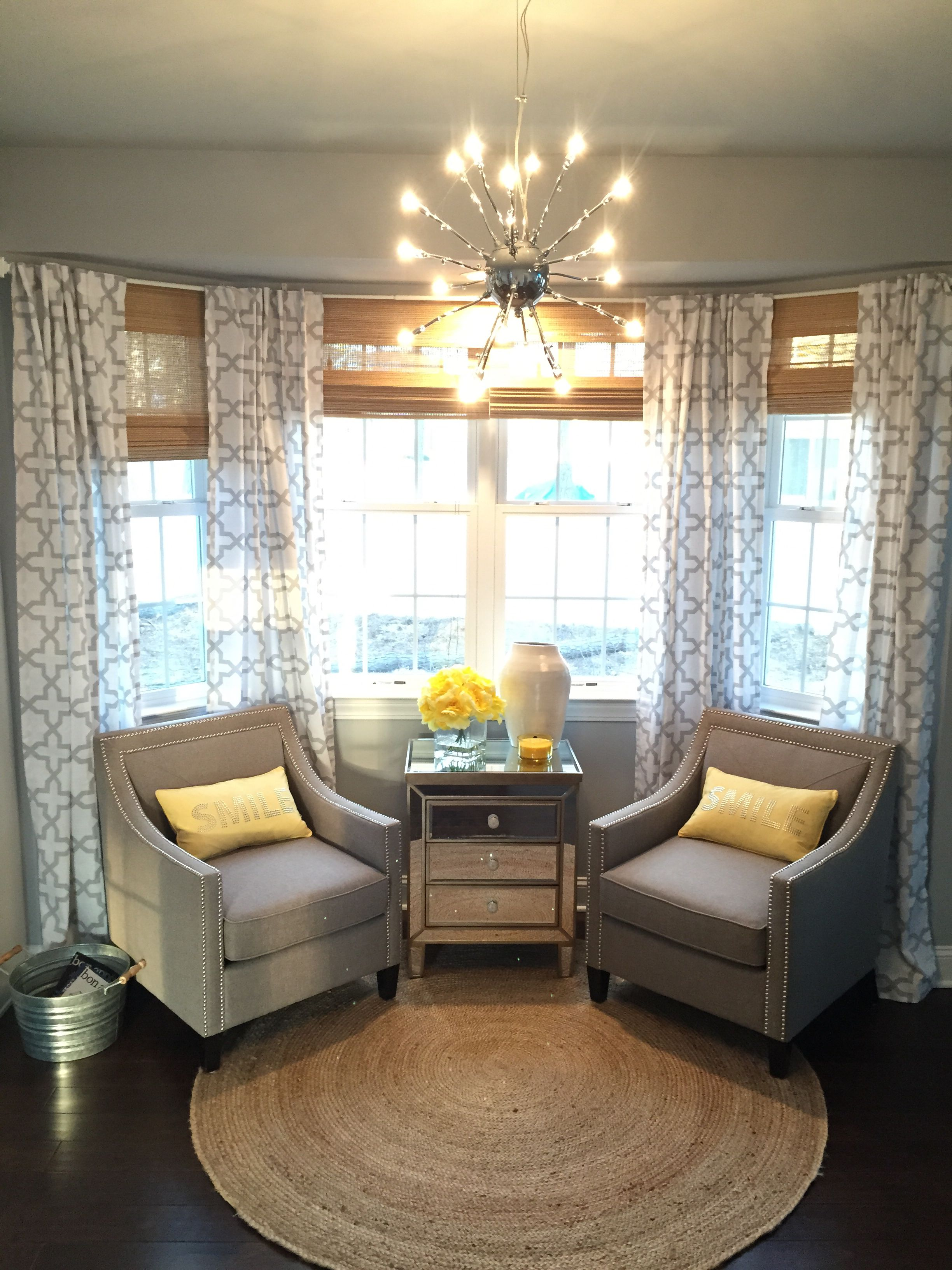 A Beautiful Bay Window With Two Neutral Taupe Linen Chairs Chrome Nail Head Detailing The Curtains Are White Gray Quatrefoil Print