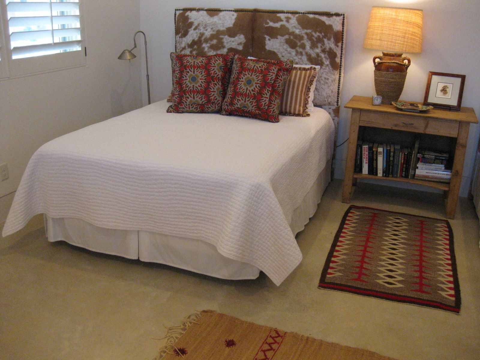 Guest House With Tony Duquette Tibetan Sun Pillows And Cowhide Headboard