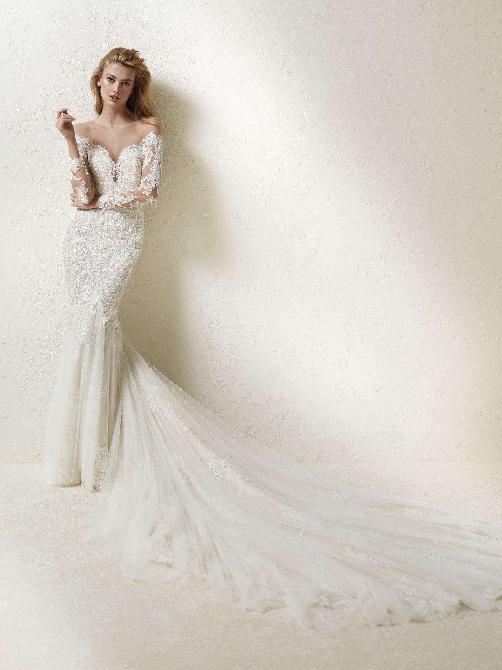 ae1d9587e Vestido de novia manga larga y cola larga - Drinea