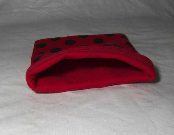 This comfy snuggle sack has a cute polka-dots pattern. They are made with fleece on the inside for comfort and a durable cotton outside. The pattern may vary slightly depending on the print size!  Approx. Size W x L: 22 x 27 cm (8.5 x 10.5 inches) These are handmade with love, and meant to keep your small ones cozy and warm! This is made for pet owners, by pet owners, in a smoke free home!  Machine or hand washable/Dryer safe  NOTE I will refund any shipping overages on applicable orders…