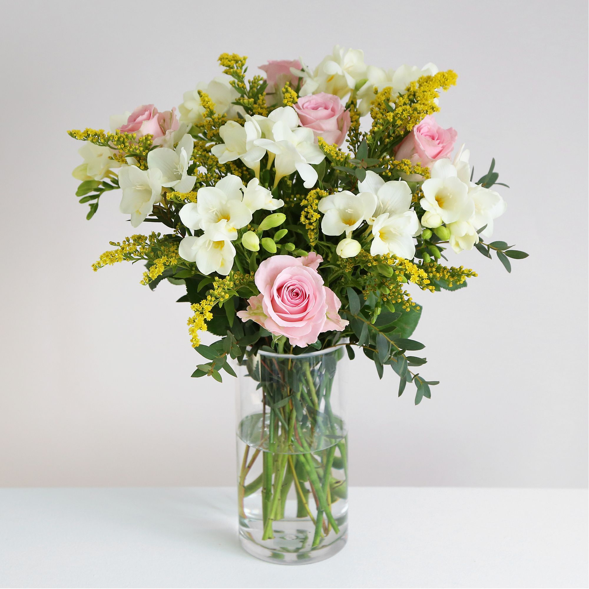 Rose And Freesia This Pretty Bouquet Smells As Good As It Looks We Are Pleased To Say That It Has Recently Bee Flower Delivery Online Flower Shop Spring Roses