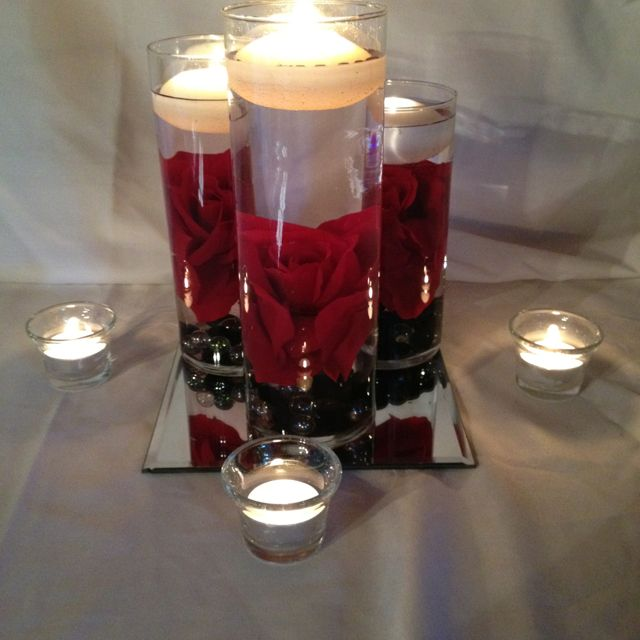 Red rose centerpiece for black , white, and red wedding by Event ...