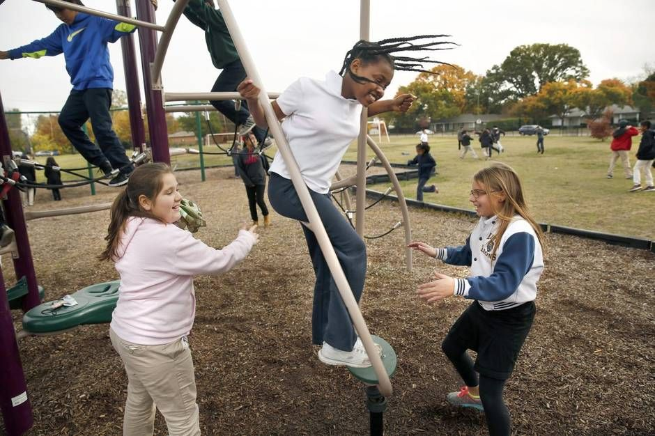 Denisa Sekic (left), Hana Salemon and Emily Burns enjoyed recess Tuesday at Preston Hollow Elementary. Students there have recess for 15 to 20 minutes a day.