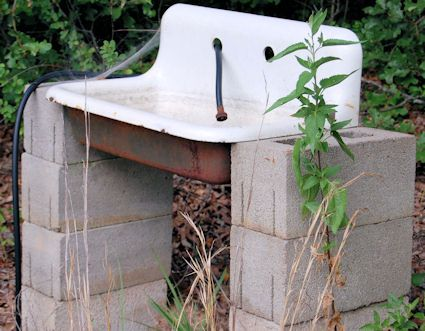 Outdoor garden sink powered by the hose with a drain that goes to