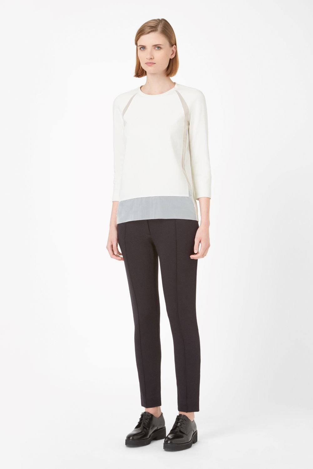 This top is made from soft jersey with contrast sheer panels along the front. A straight fit with relaxed proportions, it has raglan sleeves, a round neckline and clean raw-cut edges.
