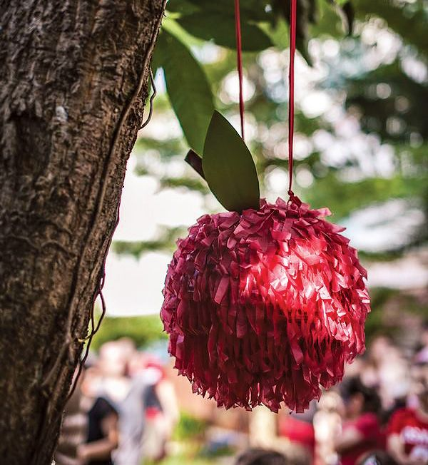 apple pinata idea - make into hot air balloon using paper lanterns / hot glue gun / cellophane or crepe paper cut into tasseled strips