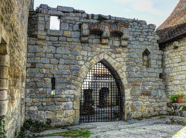 St Cirq Lapopie 16 - Medieval castle's gate by MontvalentStock