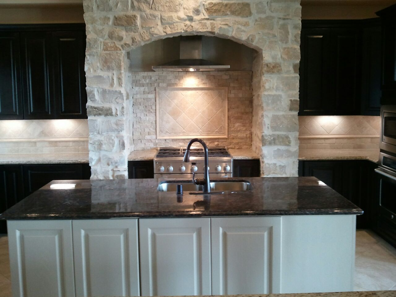 Kinsmen Homes custom built home kitchen with stone arch over range ...