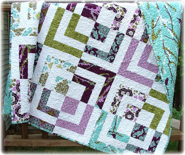 Bento box quilt. I'll be taking a class on this at a retreat soon and I need to buy fabric. These colors are pretty.