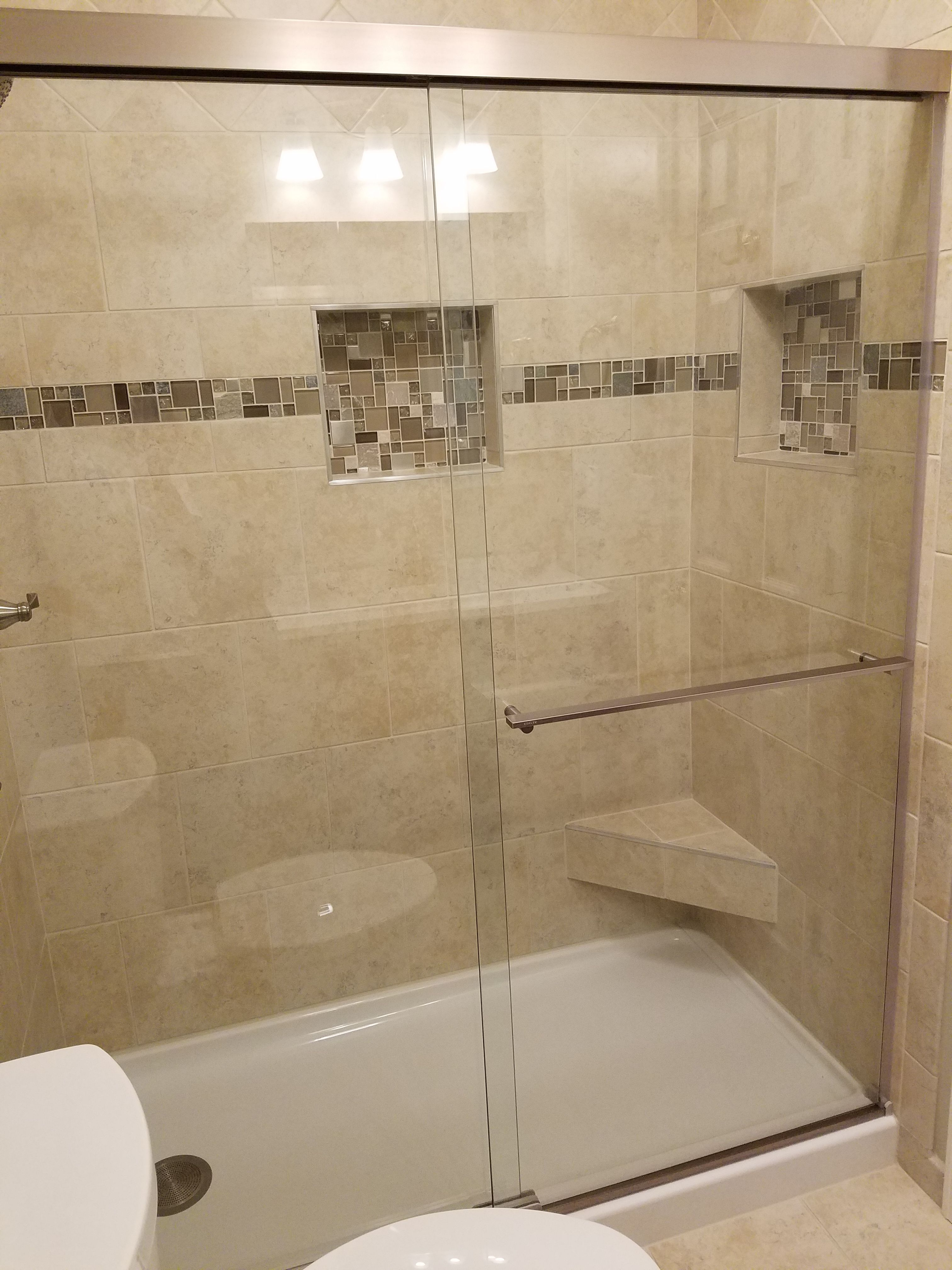 standing shower with beige tile and