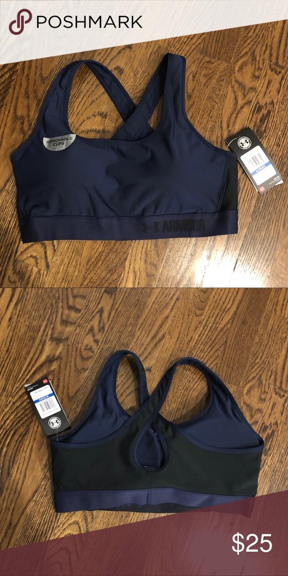 02c5cd659163a Under Armor sports bra Under Armor Navy blue and black XL women s sports bra.  Never
