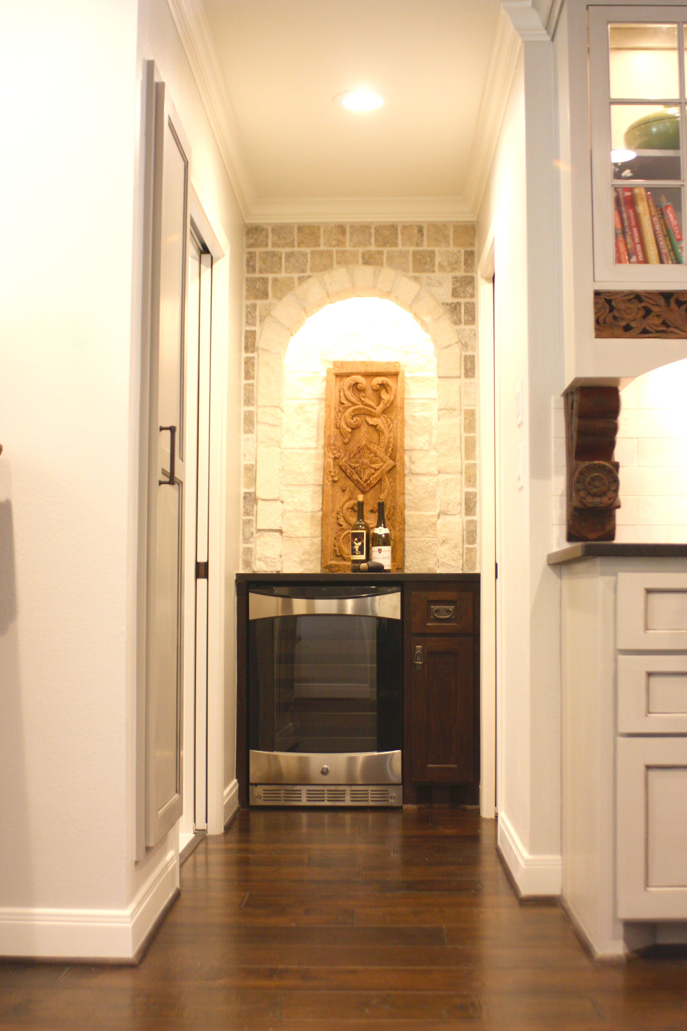 All In The Details With This One Honed Granite Stone Arch Wine Fridge