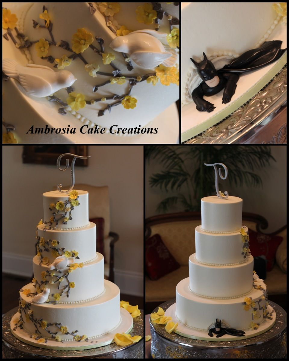 Wonderful Wedding Doves On Yellow And Grey Floral Wedding Cake With Batman Peeking  Out The Bottom.
