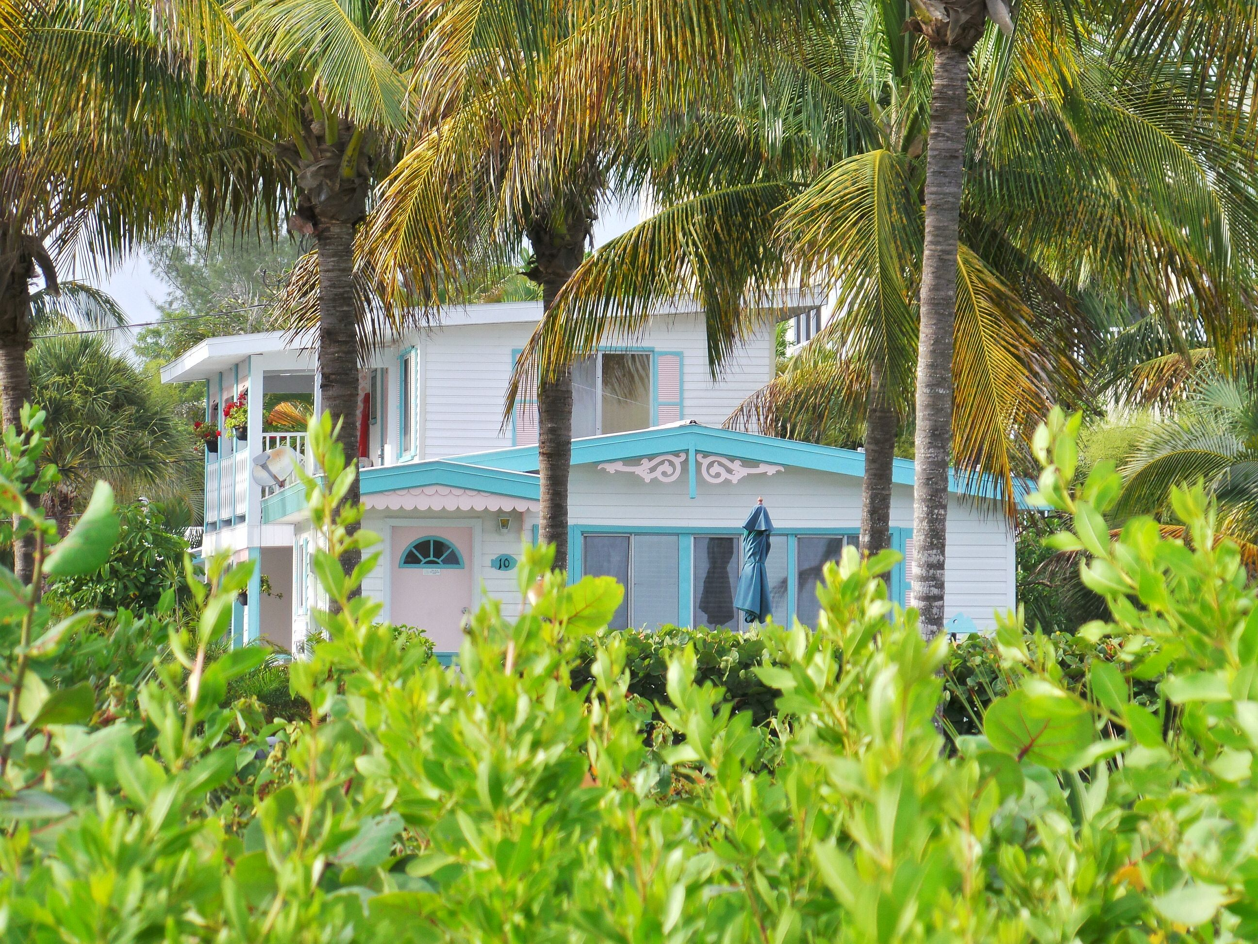 One Of Our Charming Gulf Breeze Cottages All Nestled In Between The Palms And Foliage Sanibelisland Sanibel Island Island Vacation Rentals Captiva Island