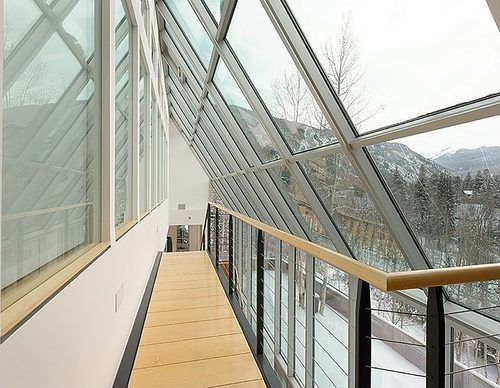 LOVE the gorgeous glass atrium in this Aspen home