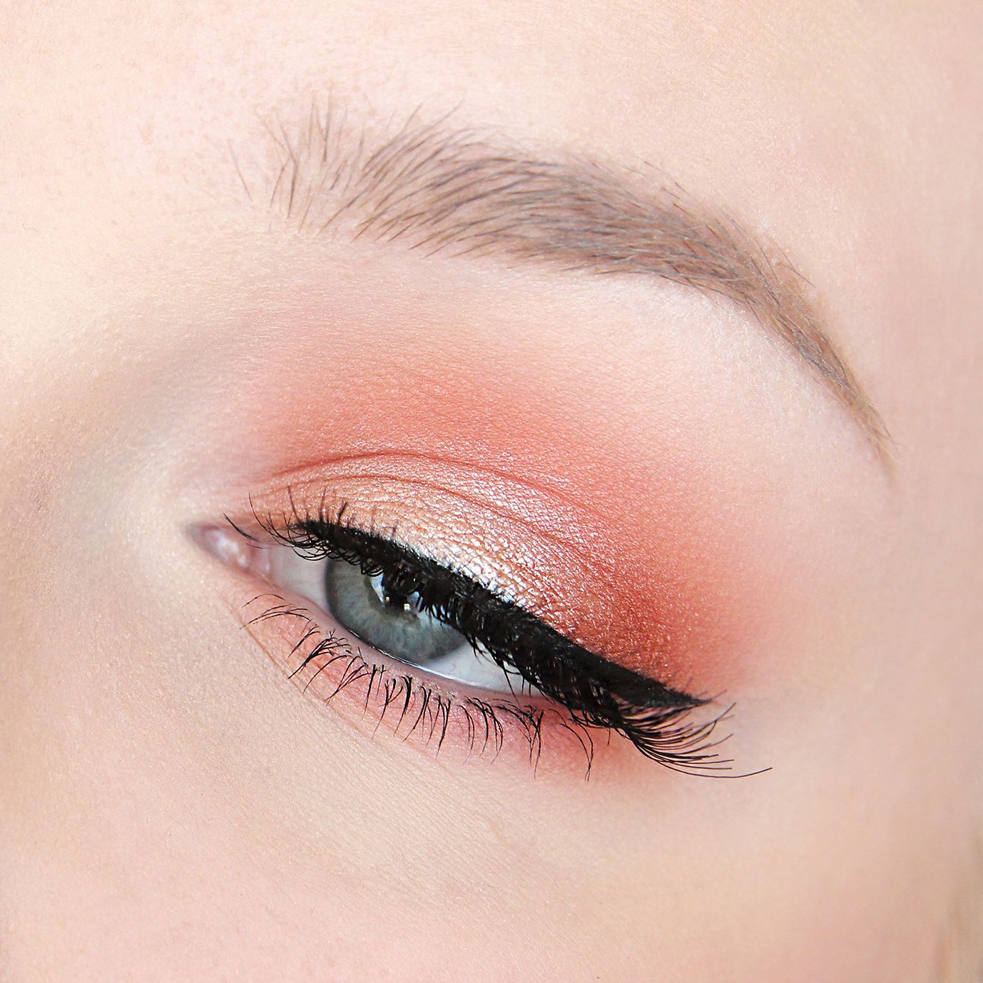 Soft and girly, this 'Coral Halo' look by Rose Herd shows off Makeup Geek Foiled Eyeshadow, In The Spotlight.