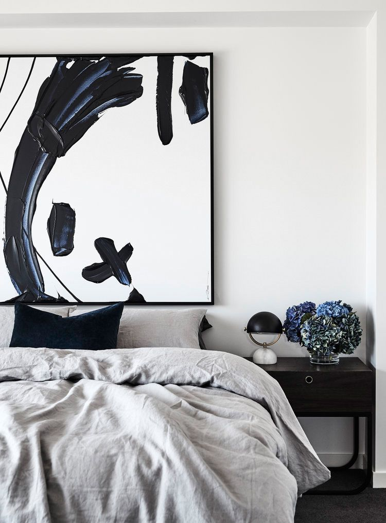 Big piece of abstract art above bed