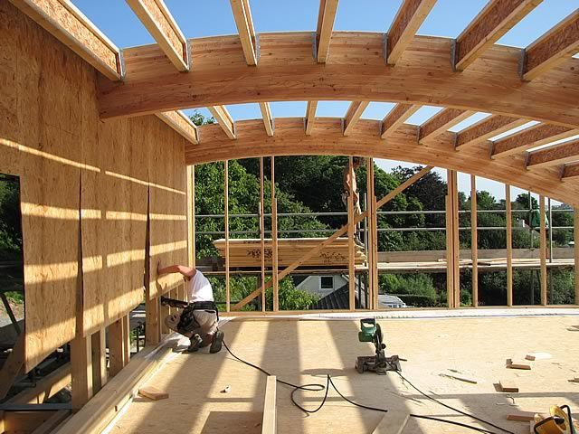 Flushing cornwall glulam beam curved roof structure for Structural beams for houses