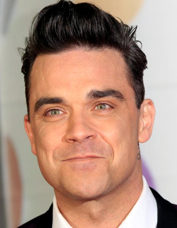 Robbie Williams 13-02-1974  Brits popzanger. Van 1990 tot en met 1995 maakte Williams deel uit van Take That. Na die periode werd hij een succesvol solozanger. In 2010 werd hij weer kortstondig lid van de boyband. https://youtu.be/iy4mXZN1Zzk