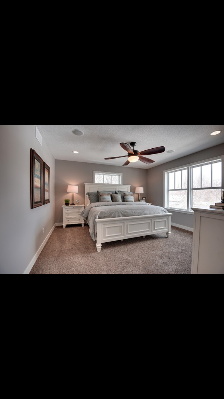 Beige carpet white furniture gray walls brown fan
