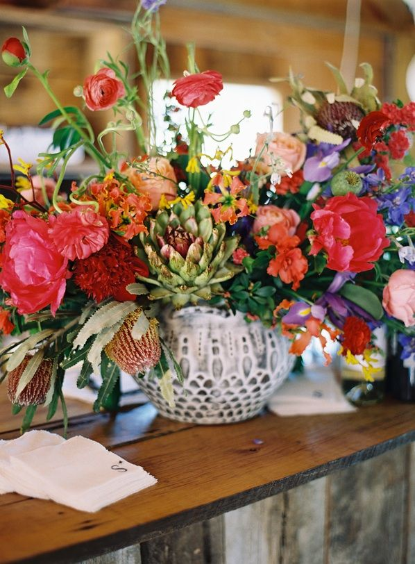 Brigh Pink Red Blue Centerpiece Urn Reception Decoration by Joy Thigpen as seen on Once Wed