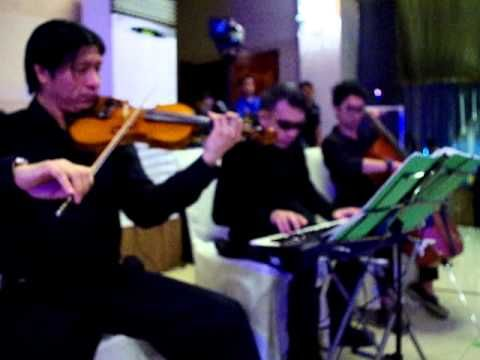 what a wonderful world armstrong by keyboardist violinist cellist trio m...