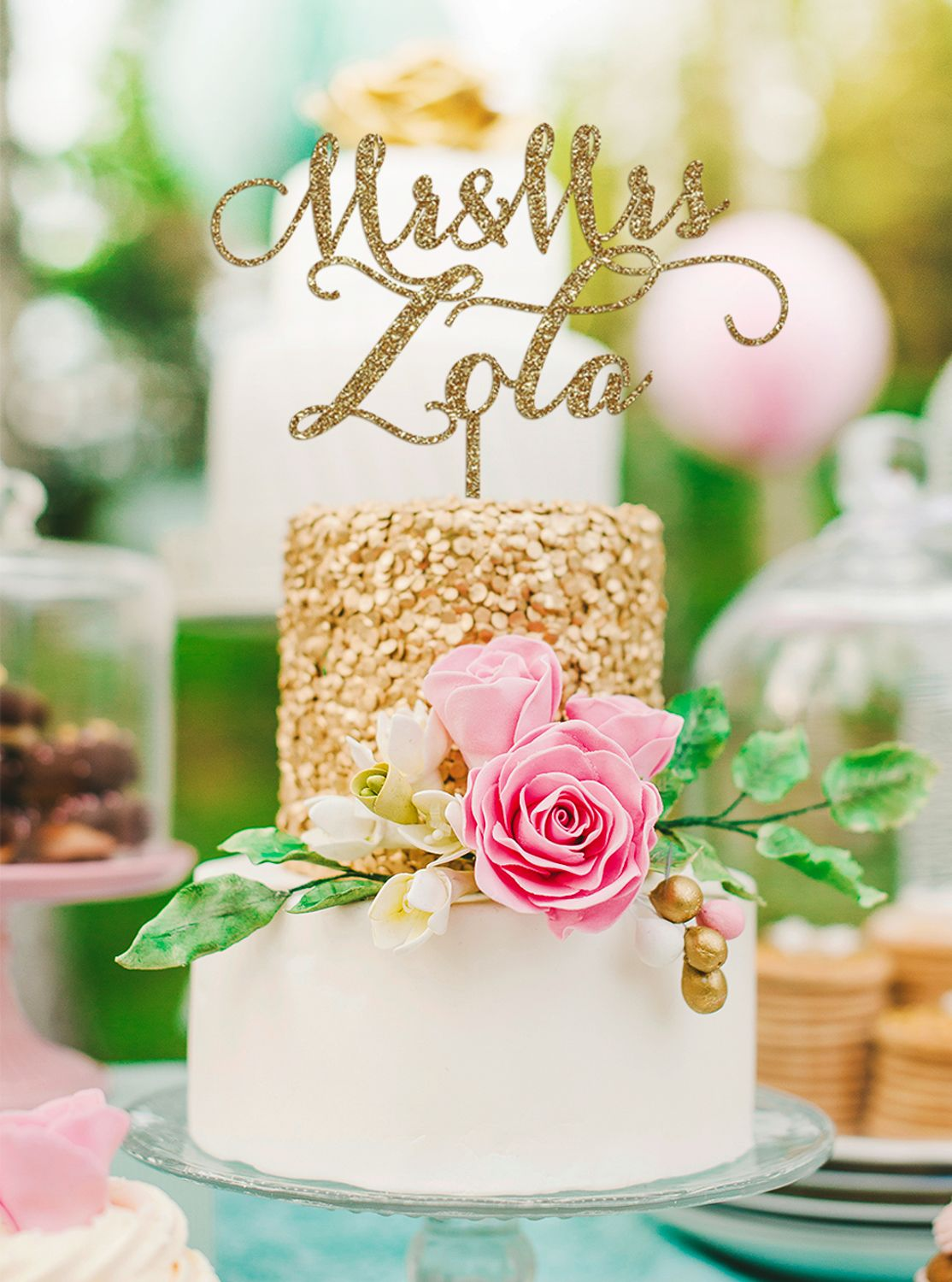 Personalized wedding cake toppers with the bride and groomus name