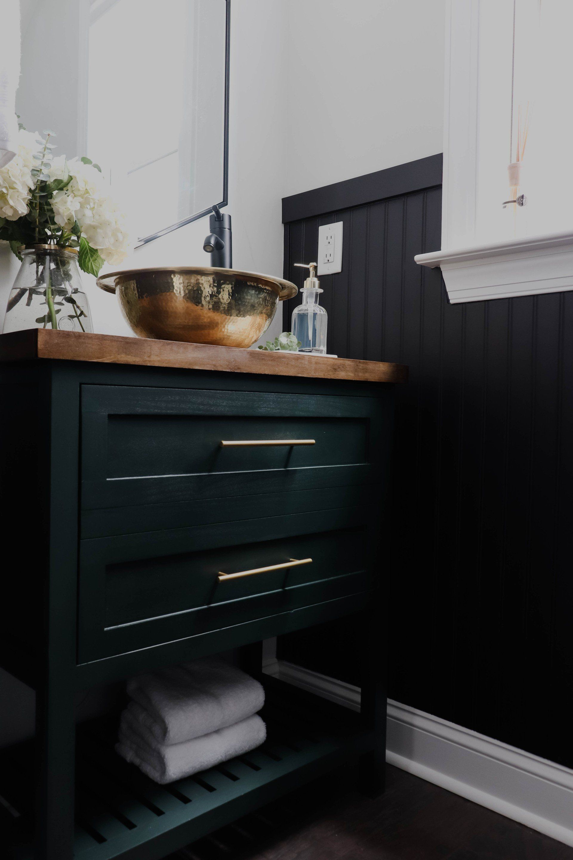 This Modern Powder Room Features A Gold Vessel Sink A Dark Green Vanity Black Beadboard And A Fa In 2020 Cheap Kitchen Decor Modern Powder Rooms Diy Bathroom Vanity