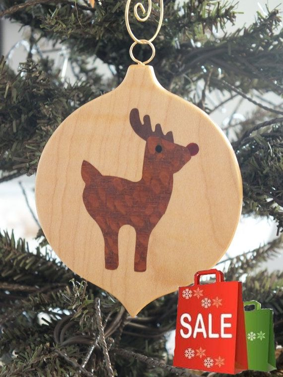 Beautiful Marquetry wood inlay Christmas ornament of Reindeer. Inlay woods are Ebony, Lacewood, Redheart and Walnut, background wood is quilted maple.