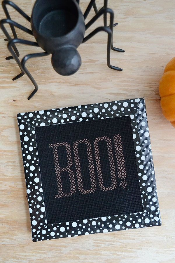 """Create a fun and easy faux cross-stitch for Halloween with this free """"BOO!"""" pattern."""