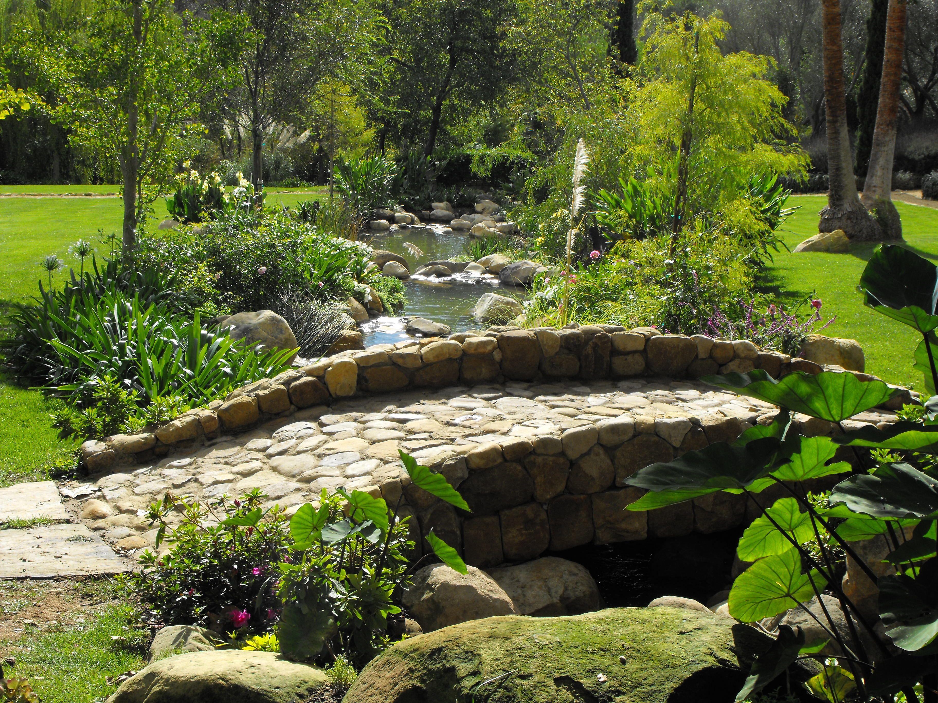 Stone Bridge Over Man Made Creek Backyard Water Feature Pond Landscaping Ponds Backyard