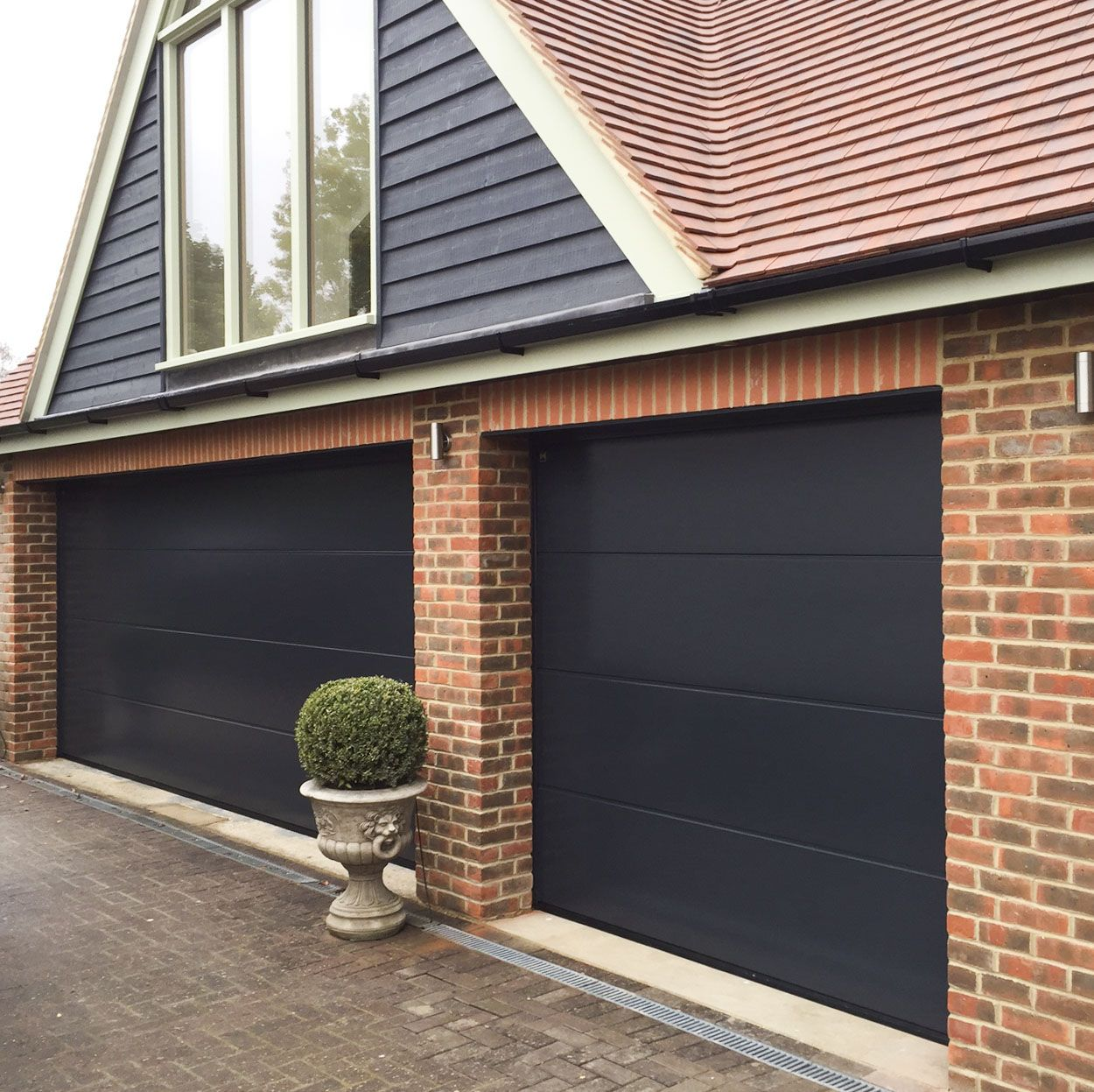 Two Beautiful Sectional Garage Doors One Double And One Single Width Garage Architecture Garage Door Styles Sectional Garage Doors Garage Door Types