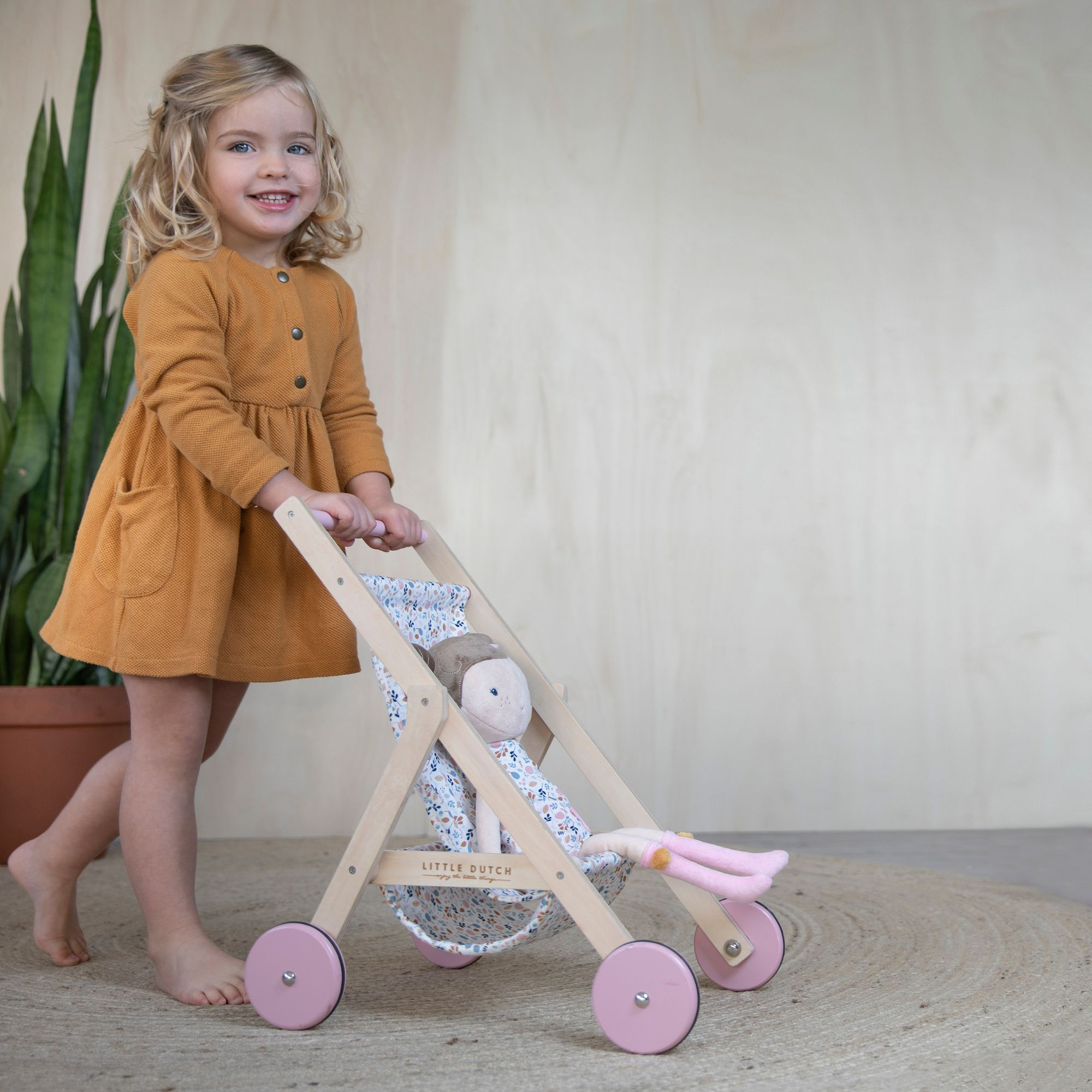 Take your doll for a walk! The wooden doll stroller has a
