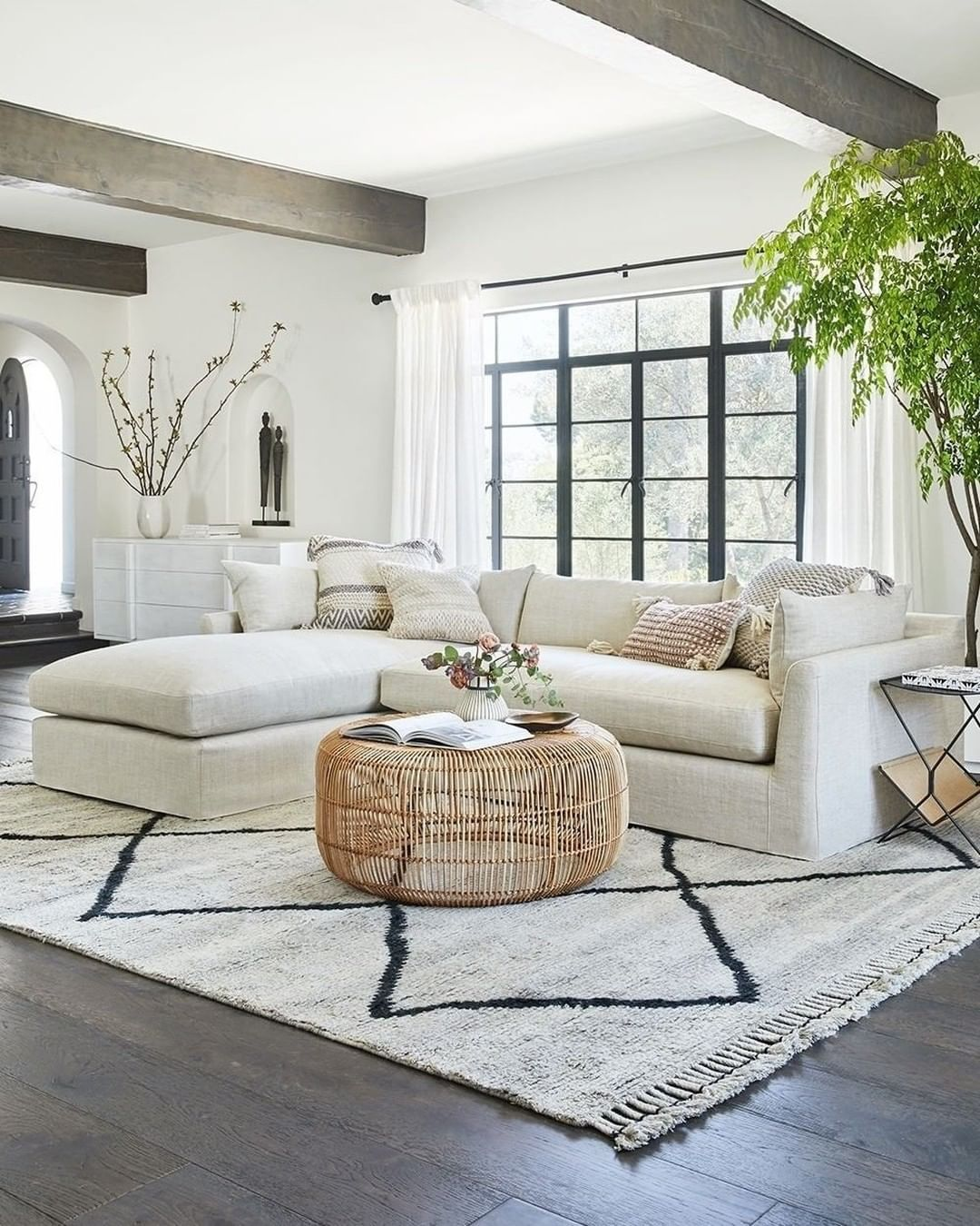 Spacious living room by @luluandgeorgia. Visualize any @luluandgeorgia item in your home with the DecorMatters app (link in bio)! Click the image to try our free home design app.  (Keywords: living room decor, living room ideas, living room designs, dream rooms, house design, home decor ideas, living room rugs, living room furniture, positive vibes, positive thoughts, boho living room)