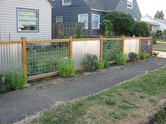 Corrugated sheet metal fence but do horizontal wood instead of hog fence.